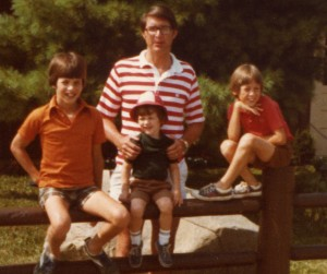 On the fence with Joe, Jon and Tom Banks, with father Joe Banks.